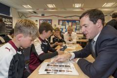 Chancellor goes back to school for lesson in money management