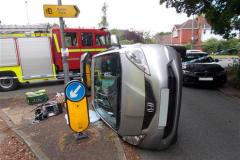 Firefighters rescue woman trapped in flipped car