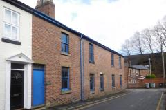 Revised plans to replace engineering workshop with terraced houses