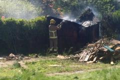 Firefighters extinguish shed fire