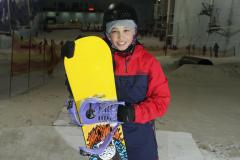 Teen snowboarder comes back in style