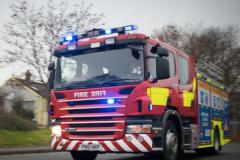 Firefighters extinguish garage and manhole fires