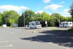 Travellers return to set up illegal encampment in town centre car park