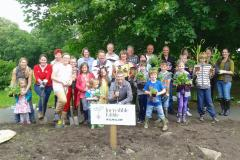 Volunteers and residents come together to plant edible plots