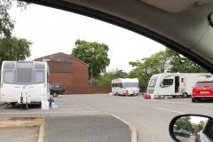 Travellers set up illegal encampment in supermarket car park