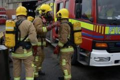 Firefighters battle garage fire for nearly two hours