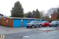 Revised plans to replace garages with three houses