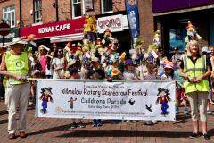 Children join the colourful scarecrow parade