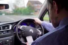 More than 75 people caught using their phones at the wheel