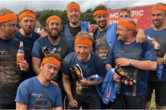 Friends get muddy in memory of Clean Team founding member