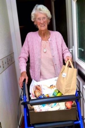 Ada receiving food parcel from Age UK