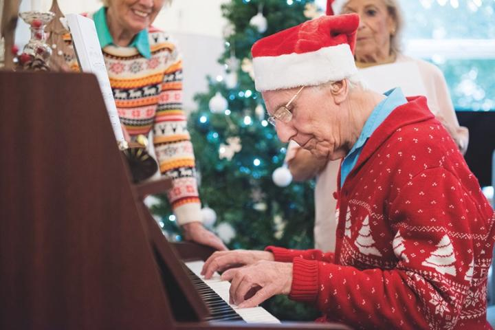 Seniors Activity Christmas playing piano_Brookview