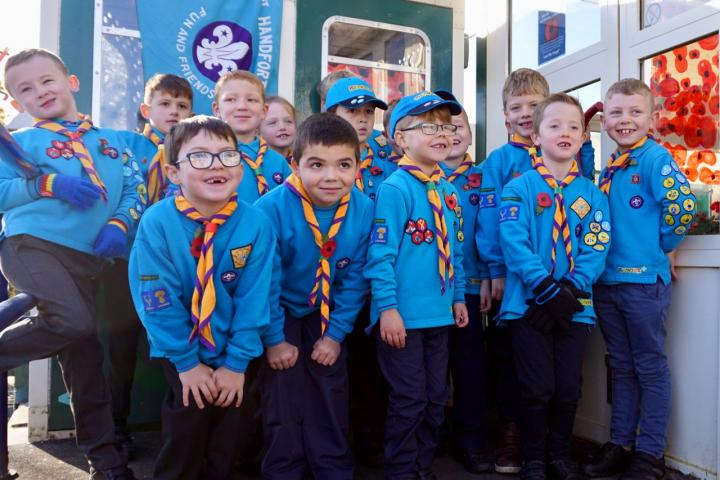 1. 1st Handforth Beavers in front of their displays