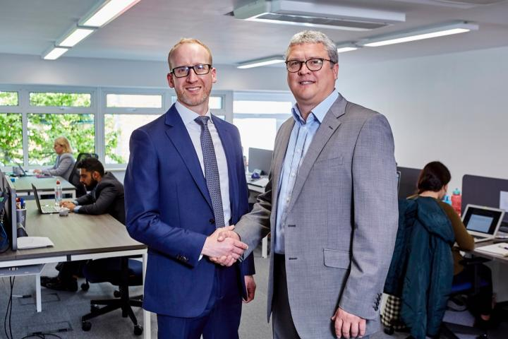 Tony Sellers, right, from Grayce with Orbit's Adam Jackson in new office space
