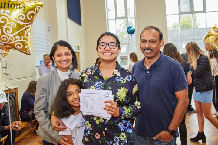 Aditi Chandana pictured with proud family after receving incredible results.