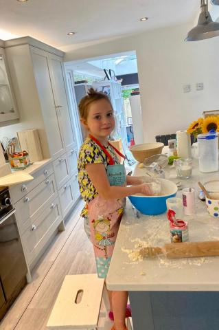 Millie making scones